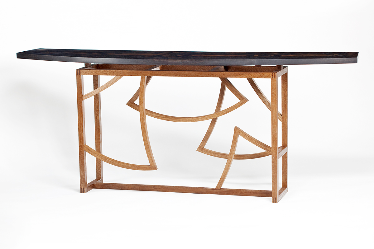 """Gingko"" Custom Wood Inlaid Parquetry Hall Sofa Table - curved sofa table features a motif of stylized Gingko leaves inlaid into the top that creates the structure of the base. Wood: 5,000 year-old English ""Bog"" Oak and fumed White Oak. Finish: Hand-rubbed varnish. Size: 14"" x 68"" x 29."