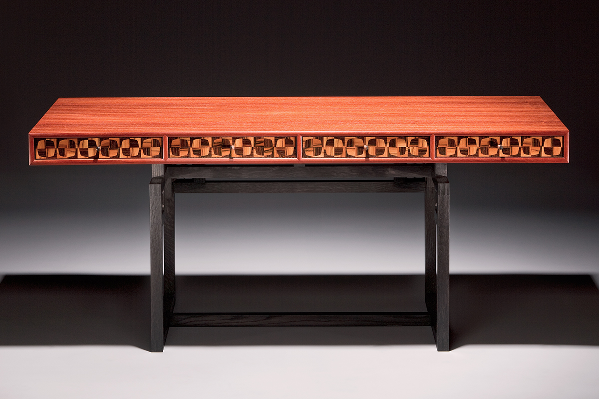 """""""Tartan"""" Modern, Custom Inlaid Parquetry Desk Table. Mid-century modernist-inspired desk features a soft-square marquetry pattern. Wood: Padouk, Brazilian Rosewood, Macassar Ebony, Maple, Ebonized Oak. Finish: Hand-rubbed varnish. Size"""": 60"""" x 32"""" x 30""""."""